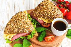 Burger sandwich with ham, cheese, tomatoes and lettuce Stock Images