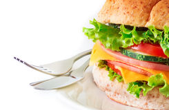 Burger sandwiches bread with bacon , ham and cheese with vegetab Stock Photography