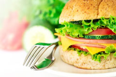 Burger sandwiches bread with bacon , ham and cheese with vegetab Royalty Free Stock Images