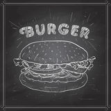 Burger scetch on a black board Royalty Free Stock Photos