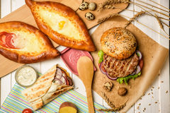 Burger and scone with egg Royalty Free Stock Photo