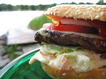 Burger by the sea. Juicy burger to be enjoyed by the water Stock Photos