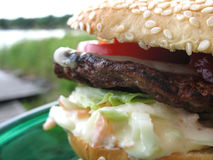 Burger by the sea. Juicy burger to be enjoyed by the water Stock Photo