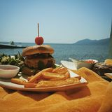 Burger by sea Stock Photo
