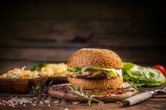 Burger in sesame bun Stock Photos