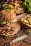 Burger in sesame bun Stock Photography