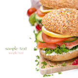Burger with smoked salmon and vegetables, close-up, isolated Stock Photography