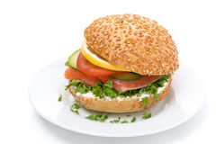 Burger with smoked salmon and vegetables on the plate, isolated Stock Photo
