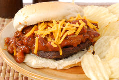 Burger smoothered in chile Royalty Free Stock Photography