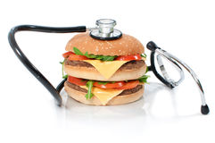Burger with stethoscope Royalty Free Stock Images