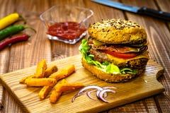 Burger with sweet potato fries stock photos