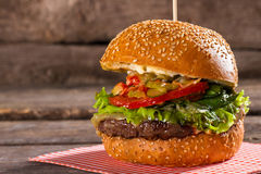 Burger with tomatoes on stick. Royalty Free Stock Photo