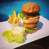 Burger Tower. Serves With Coleslaw And Fries Royalty Free Stock Image