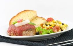 Burger- und Knoblauchbrot Lizenzfreie Stockbilder