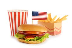 Burger with USA flag, French fries and drink on white background. Traditional American food stock image