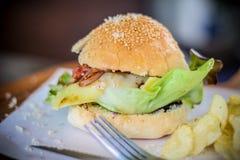 Burger vegetables salad bacon  potato junk Food meat Parmesan cheese  onions Sesame catchu Stock Photo