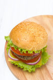 Burger with a vegetarian cutlet and fresh vegetables, top view Royalty Free Stock Image