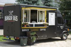 Burger on wheels. Diner in the car on the street Royalty Free Stock Photography