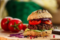 Burger and Whole Wheat Bread. Home made burger with beef, vegetables and whole wheat bread stock image