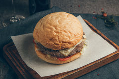 Burger. On wood background. Russia, Yekaterinburg stock images