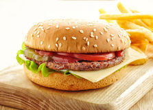 Burger on wooden cutting board Stock Images