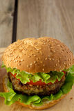Burger on wooden plate Stock Photo
