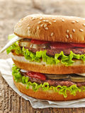 Burger on wooden table Royalty Free Stock Photo