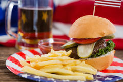 Burger on wooden table with 4th july theme Stock Image
