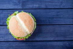 Burger on wooden table top view stock images