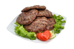 Burgers. Juicy burgers with green salad and tomato Royalty Free Stock Photo