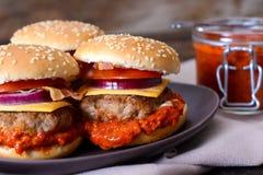 Burgers with ajvar salad Stock Photos