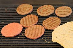Burgers barbaque on grill stock photos