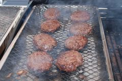Burgers on a barbecue Royalty Free Stock Image