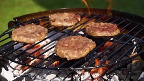 Burgers on barbecue grill stock footage