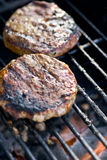 Burgers on the barbeque Stock Images