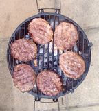 Burgers on a BBQ Royalty Free Stock Photography