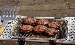 Burgers being cooked on portable BBQ Stock Image