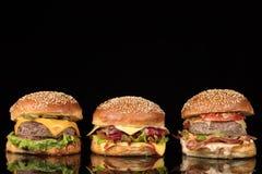 Burgers On Black Glass Royalty Free Stock Photos