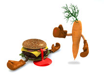 Burgers and carrot that fight. The winner is the carrot with vitamins Royalty Free Stock Images