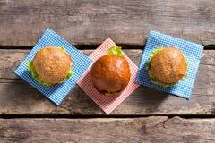 Burgers on checkered napkins. Stock Photo