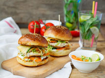 Burgers with chicken and stuffed  juicy with cucumber, carrots a Royalty Free Stock Image