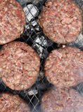 Burgers cooking on a barbecue Stock Image