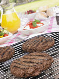 Burgers Cooking On Barbeque Grill Stock Photos