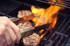Burgers cooking on the grill Stock Image