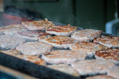 Burgers Cooking On Grill At Street Food Stall Royalty Free Stock Photography