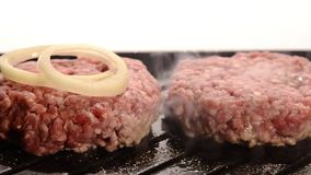 Burgers cooking Stock Photos
