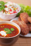 Burgers, crab salad and Russian Royalty Free Stock Photos