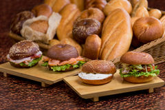 Burgers with fish on wooden plank on bread background. Close view stock photos