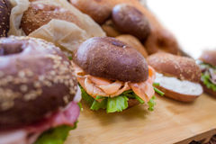 Burgers with fish on wooden plank on bread background. Close view stock photo