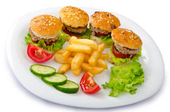 Burgers and french fries Stock Images